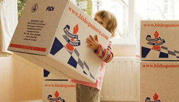 child holding bishop's move box