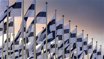 Flags of Finland against the sky