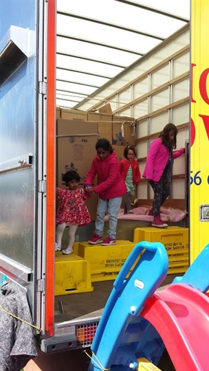 Kids navigating our removal van obstacle course in Scotland