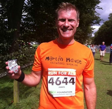 James Comley completes his 2 runs for charity.